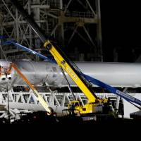 A SpaceX Falcon 9 rocket is prepared for another launch attempt for a supply mission to the International Space Station from historic launchpad 39A at the Kennedy Space Center in Cape Canaveral, Florida. | REUTERS