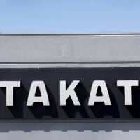 A sign with the Takata logo is seen outside the Takata Corporation building in Auburn Hills, Michigan, in 2015. | REUTERS