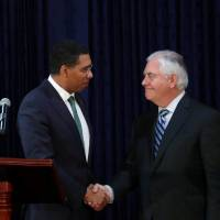 Jamaican Prime Minister Andrew Holness (left) and U.S. Secretary of State Rex Tillerson meet in Kingston Wednesday. | REUTERS