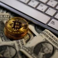 Zaif, a cryptocurrency exchange run by Osaka-based Tech Bureau Corp., suffered a system glitch that let users purchase bitcoins for free for about 20 minutes last week. | REUTERS