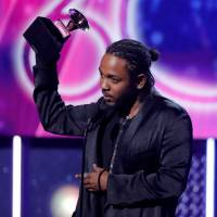 Summer vacation: Kendrick Lamar accepts the Grammy for best rap album for 'Damn.' last month. The artist has also been announced for this year's Fuji Rock Festival in Niigata Prefecture. | REUTERS