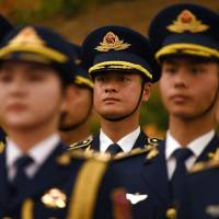Members of a military honor guard rehearse ahead of a welcome ceremony for British Prime Minister Theresa May in Beijing's Great Hall of the People on Jan. 31.   AFP-JIJI