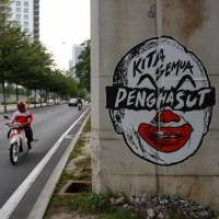 Malaysian court jails and fines artist for clown caricature of prime minister