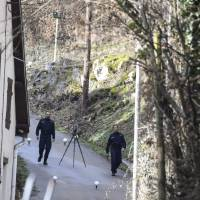 Forensics gendarmes perform a search in a street of Domessin on Wednesday near the home of Nordahl Lelandais, a 34-year-old former military dog handler charged over the abduction and murder in August 2017 of Maelys de Araujo. Maelys de Araujo disappeared from a wedding only a half-hour drive from Chambery. | AFP-JIJI