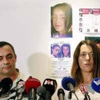The father of missing girl Maelys, Joachim de Araujo, and his wife, Jennifer, hold a press conference in Lyon, central France, in September. French authorities say a man in custody confessed to 'unintentionally' killing the 9-year-old girl whose disappearance from a wedding party in the Alps prompted nationwide concern. | AP