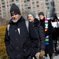 Immigration activist Ravi Ragbir walks during a demonstration against deportations at Federal Plaza in Manhattan, New York, Thursday. | REUTERS