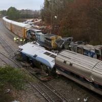 Authorities investigate the scene of a fatal Amtrak train crash in Cayce, South Carolina, Sunday. At least two were killed and dozens injured. | TIM DOMINICK / THE STATE / VIA AP