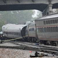 Emergency responders are at the scene after an Amtrak passenger train crashed into a freight train and derailed in Cayce, South Carolina, Sunday. | REUTERS