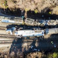 The site of an early morning train crash of an Amtrak train (bottom) into a CSX freight train in Cayce, South Carolina, is seen Sunday. | AP