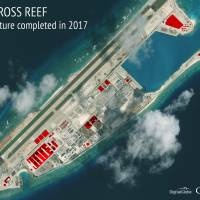 An annotated satellite image of Fiery Cross Reef in the Spratly island chain of the South China Sea shows areas where China has conducted construction work above ground during 2017. | CSIS ASIA MARITIME TRANSPARENCY INITIATIVE/DIGITALGLOBE / VIA AP