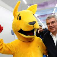 Thomas Bach, president of the International Olympic Committee, poses with BK, the boxing kangaroo — the Australian Olympic team mascot — during his visit to the main press center in Pyeongchang, South Korea, on Monday.   REUTERS