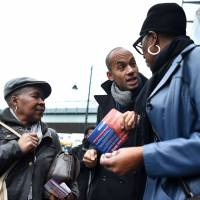 Opposition Labour lawmaker Chuka Umunna campaigns, along with pro-European activists, on the streets of Brixton, south London, on Friday,   AFP-JIJI