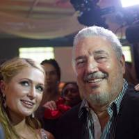 Fidel Castro Diaz-Balart, son of the late Cuban leader Fidel Castro, poses with Paris Hilton as she takes a selfie during the gala dinner of the closing of the XVII Habanos Festival, in Havana in 2015. | REUTERS