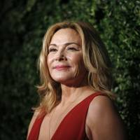 British-Canadian actress Kim Cattrall poses on the red carpet as she attends the 60th London Evening Standard Theatre Awards in 2014. Appeals by 'Sex and the City' actress Kim Cattrall for help in finding her missing brother ended in sadness on Sunday when she announced his death. 'It is with great sadness that myself and my family announce the unexpected passing of our son and brother, Chris Cattrall,' she said in a tweet, less than 24 hours after publicly appealing for help in finding him. | AFP-JIJI