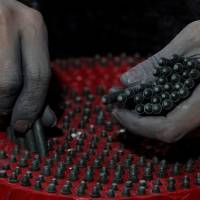 An employee inserts pyrotechnics into a case at Liuyang Standard Fireworks Manufactory in Liuyang, China, on Jan. 29.   REUTERS