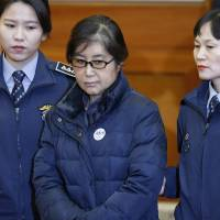 Choi Soon-sil, the former confidante of ousted South Korean President Park Geun-hye, arrives for a hearing in Park's impeachment trial at the Constitutional Court in Seoul on Jan. 16. | AFP-JIJI
