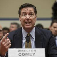 Then-FBI Director James Comey testifies before the House Oversight Committee about Hillary Clinton's email investigation, at the Capitol in Washington in 2016. Text messages between two FBI officials that have been reviewed by The Associated Press show they spoke admiringly of Comey at the time. The text messages were provided by the Justice Department to Congress, and are part of an inspector general investigation into the handling of the Hillary Clinton email inquiry. One exchange took place in July 2016 as Comey defended to Congress the FBI's decision not to bring charges in that case. | AP