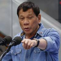 Philippines' Duterte plays down Beijing's military facilities in disputed South China Sea