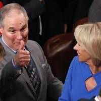 U.S. Environmental Protection Agency (EPA) Administrator Scott Pruitt gives a thumbs up across the House chamber floor as he passes Education Secretary Betsy DeVos after U.S. President Donald Trump delivered his State of the Union address to a joint session of the U.S. Congress on Capitol Hill in Washington Tuesday. | REUTERS