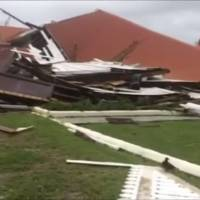 This image made from video shows parliament house damaged by Cyclone Gita in Nuku'alofa, Tonga, Tuesday. Tonga began cleaning up Tuesday after the cyclone hit overnight, while some people in the nearby Pacific nation of Fiji began preparing for the storm to hit them. | TVNZ / VIA AP