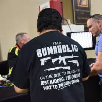 A gun enthusiast attends the South Florida Gun Show at Dade County Youth Fairgrounds in Miami, Florida, on Feb. 17. | AFP-JIJI