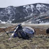 A research helicopter that was brought down by a leaping elk in the mountains of eastern Utah is seen Monday. | AP