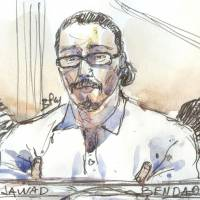 This file courtroom sketch created at the palais de Justice court in Paris on Jan. 24 shows Jawad Bendaoud, accused of harboring two of the jihadis in the aftermath of the November 2015 Paris attacks, in the dock. Jawad Bendaoud, the man who rented his flat to Islamic State jihadis, was found not guilty on Wednesday in the first trial stemming from the 2015 Paris attacks that left 130 people dead. | BENOIT PEYRUCQ / VIA AFP-JIJI