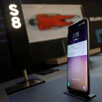 Samsung Electronics' Galaxy S8 smartphone is displayed at the company's booth in Pyeongchang, South Korea on Friday.   REUTERS