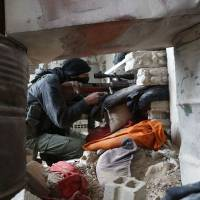 Syria regime forces ready to blitz rebel enclave near Damascus