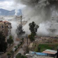 Smoke billows during Syrian government bombardments on Kafr Batna, in the besieged eastern Ghouta region on the outskirts of the capital Damascus, on Thursday. | AFP-JIJI