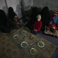 Syrian civilians take shelter in a basement in Mudayra, in the besieged eastern Ghouta region on the outskirts of the capital Damascus, last month. | AFP-JIJI