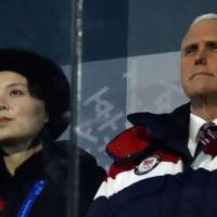U.S. Vice President Mike Pence and North Korea's Kim Jong Un's sister, Kim Yo Jong, attend the Feb. 9 opening ceremony of the Pyeongchang 2018 Winter Olympic Games at the Pyeongchang Stadium. Pence on Thursday assailed the North Korean leader's sister who sat near him at the Olympics as part of an 'evil family clique' that oppresses millions.   AFP-JIJI