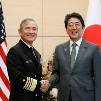 United States Pacific Command chief Adm. Harry Harris shakes hands with Prime Minister Shinzo Abe during a courtesy visit to Tokyo in November. | AFP-JIJI