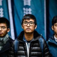 Hong Kong's leading democracy activists (from left to right) Joshua Wong, Nathan Law and Alex Chow arrive outside the Court of Final Appeal in Hong Kong on Tuesday. | AFP-JIJI