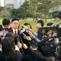Pro-independence activist Andy Chan speaks to journalists in Hong Kong on Tuesday. | REUTERS