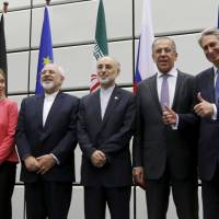 Top officials responsible for the Iranian nuclear deal gather for a group picture at the United Nations building in Vienna in July 2015. | REUTERS