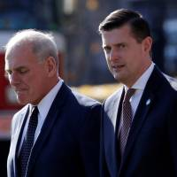 White House Chief of Staff John Kelly (left) walks with White House Staff Secretary Rob Porter to depart with U.S. President Donald Trump aboard the Marine One helicopter from the White House in Washington Nov. 29. | REUTERS