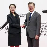 South Korean President Moon Jae-in shakes hands with Kim Yo Jong, younger sister of North Korean leader Kim Jong Un, at the presidential Blue House in Seoul on Saturday.   AP
