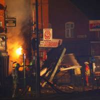 Fiery blast levels shop and flat above it in English city of Leicester