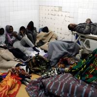 Migrants who were injured in a truck crash are seen at a hospital in Bani Walid town, Libya, Wednesday. | REUTERS