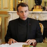 French President Emmanuel Macron speaks Friday during a Trianon Council meeting aiming to strengthen links between France and Russia at the Elysee Palace in Paris. | REUTERS