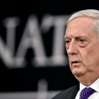 U.S. Defence Minister James Mattis reacts Thursday as he delivers a speech during a press conference on the second day of Defense Ministers Council meeting at the NATO headquarters in Brussels. Artificial intelligence and its impact on weapons of the future has made Mattis doubt his own theories on warfare. | AFP-JIJI