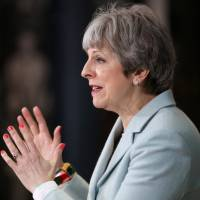 British Prime Minister Theresa May delivers a speech to students and staff during her visit to Derby College in Derby, Britain, on Monday. | POOL / VIA REUTERS