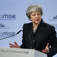 Britain's May wins backing for EU security pact, but timing unclear