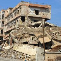 A general view taken Wednesday shows destruction in the northern Iraqi city of Mosul. Iraq received pledges totalling $30 billion at an international conference for reconstruction of the war-torn country, the host Kuwait announced. | AFP-JIJI