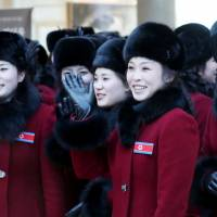 Members of the North Korean cheering squad arrive at a hotel in Inje, South Korea, on Wednesday. | REUTERS
