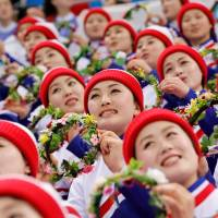 North Korean cheerleaders attend a men's ice hockey match pitting the South Korean team against the Czech Republic at Gangneung Hockey Center in Gangneung, South Korea, on Feb. 15 during the Pyeongchang 2018 Winter Olympics. | REUTERS