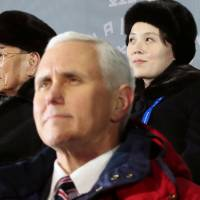 U.S. Vice President Mike Pence sits in front of North Korea's nominal head of state, Kim Yong Nam, and North Korean leader Kim Jong Un's younger sister, Kim Yo Jong, during the Winter Olympics opening ceremony in Pyeongchang, South Korea, on Friday.   YONHAP / VIA REUTERS