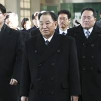 Kim Yong Chol (center), vice chairman of North Korea's ruling Workers' Party Central Committee, arrives at the DMZ to attend the closing ceremony of the Winter Olympics on Sunday. | AP