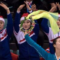 North Korean cheerleaders attend the hockey match between Sweden and the unified Korean women's Olympic team on Monday in Gangneung, South Korea. | AFP-JIJI